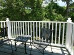 Deck with chairs and table off Master bedroom