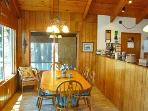 Dining room with oak furniture and lake view