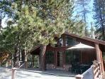 DONNER LAKE VACATION RENTALS showing large deck, dining table and umbrella