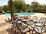 Trulli Stella outside dining table beside private pool