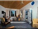 upstairs sunroom with futon (large double bed), airtight stove, cathedral ceiling