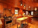 A cozy, rustic kitchen with top-end appliances