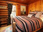 The main floor bedroom with a queen size bed