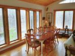 bright and open dining overlooks yard, seasonal stream - open design to kitchen/LR