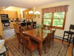 Dining room ( with attached dining deck  with BBQ gas grill overlooking lake)