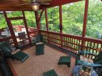 Screened in porch connected to dining deck - both overlooking waterfront