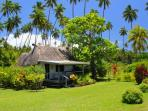 Your Coco Cottage is surrounded by trimmed lawns, flower and fruit gardens