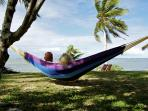Swing to the rhythm of the waves, breezes and swaying palm leaves above - the ultimate in relaxation