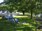 The Lakehouse's shady front lawn and firepit..