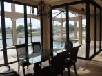 Enjoy breakfast while viewing pool, dock & lagoon. You may even see a dolphin while sipping coffee.