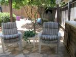 Step outside the guest bedroom two to a mini patio where you can sit & watch the oranges grow1