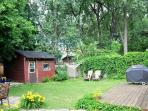 HUGE backyard surrounded by mature trees, this is a real OASIS so close to all the action!