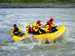 Wild rides on class 2 to 5 river rafting on local glacier fed rivers