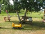 Kids-Size Picnic Table under the big shade tree is perfect for quiet times with a book or snacks
