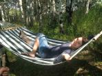 The hammock beckons you to nap in the meadow, near the babbling brook..Wade, dip feet from bridge