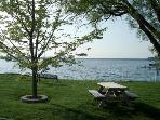 Point Chautauqua's private beach is a short 2 minute walk from the front door.