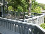 VIew of deck from the upper level outside the screened porch.