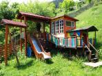 Children Playground: 2 small houses, mini hiking trail, tobogan, swing