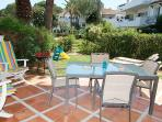 The terrace has dining table with 4 chairs and recliners