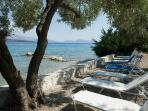 Exclusive private beach area with free sunbeds for our guests