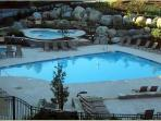 Heated pool open all year with 2 in ground hot tubs behind it