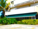 Condo from the exterior with awning for your convenience