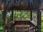 Breakfast palapa and casual area by a waterfall