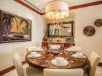 F102 Bali Hai Pool Villa - Indoor Dining at a 60-inch round Mango-wood indoor Dining Table, Bone China, Crystal...