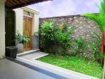 On the opposite side of the bathroom garden are doors leading to steps down to the pool area.
