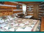 Master bedroom downstairs has king bed and a 6 foot jacuzzi