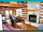 Cozy living area with wood burning fire place