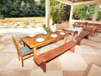 Huge open space by the pool with sofas and dining tables in Villa Dolores