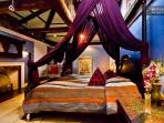 Master bedroom with king bed and tent canopy