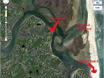 Aerial of house (left arrow) and the waterway to the National Seashore and Nauset Beach.