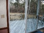 Slider in dining area leads to roomy deck