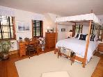 Bedroom 2 in the Main House is upstairs and offers a Queen Canopy Bed.  Hall bath serves both upstairs bedrooms.