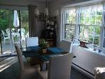 Dining area in Carrage House with slider to private patio.