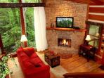 Fireplace can be seen throughout the cabin
