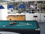 Games room with pool and foosball