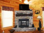 Stacked stone gas fireplace.  42' HDTV