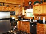 Fully equipped kitchen with beautiful granite and stainless appliances