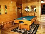 Game room with pool table and video arcade