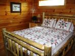 Lower level bedroom with beautiul log bed