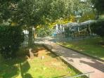 neighborhood, park with cafes