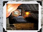 Birch wallpapered loft bedroom with log bed