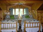 The twin beds in the upstairs bedroom