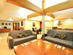 lounge with comfortable sofa and large teak coffee table