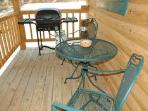 Lakeview Log Cabin back porch with gas grill.