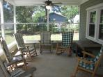 Large porch equipped with two ceiling fans and 6 famous