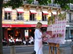 A summer night at Carrefour de l'Odéon, with many fun 'people-watching' spots
